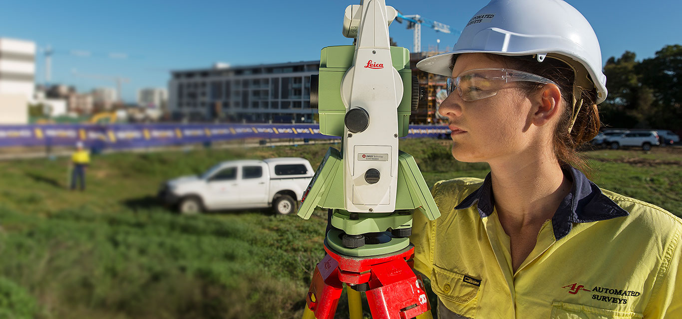 Surveyor working with theodolite - Automated Surveys