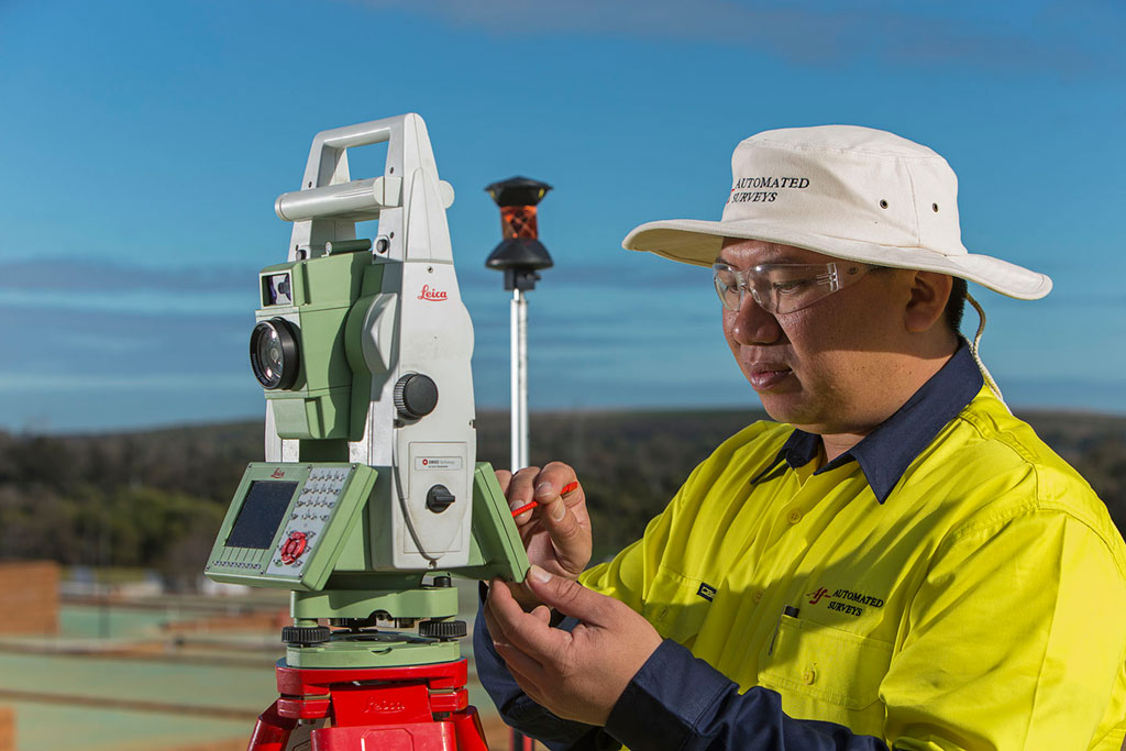 Residential Development Project, surveyor with theodolite - Automated Surveys